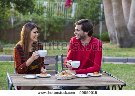 stock-photo-happy-smiling-couple-having-lunch-in-garden-99959015